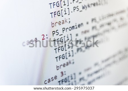 Software developer programming code on computer. Abstract computer script source code. Shallow depth of field, selective focus effect. Code text written and created entirely by myself.