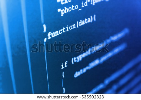 Software engineer at work. Abstract source code background. Coding script text on screen. Software source code. Writing programming functions on laptop. Mobile app developer. Software development.