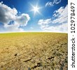 Soil cracked Background mud puddle marsh well blue sky rice - stock photo