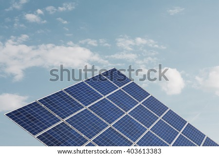 Solar panel against soft cloudy sky