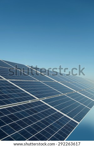 Solar panel grey colour on clear blue sky background copyspace, vertical picture