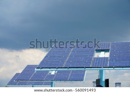 solar panels in a row in solar power station in cloudy day
