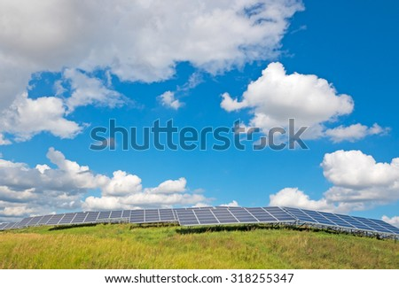 solar panels under a blue summer sky