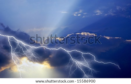 Solar ray illuminates the dark thunderstorm clouds, struck by the high-current discharge of lightning.
