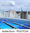solarpanel on roof of building that is new microdistrict - stock photo