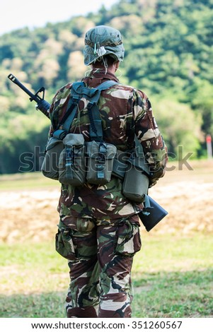 Soldier with rifle in hand