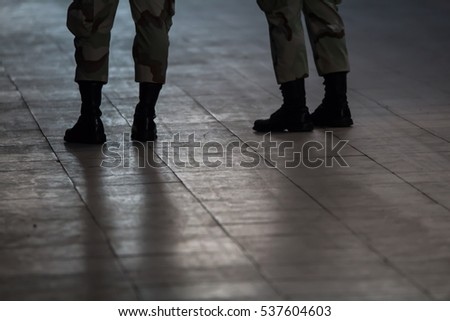 Soldiers stand on floor