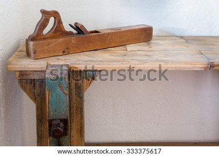 Solid wood workers bench with wooden smoothing plane and large vise