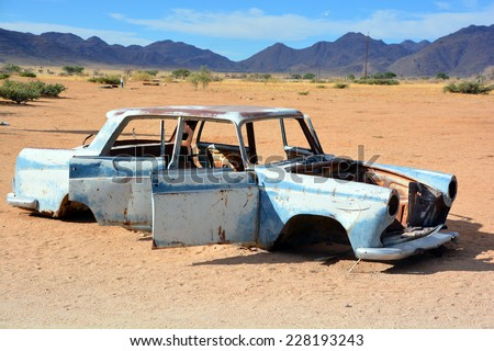 Solitaire, Namibia  SEPT, 29: Abandoned car near a service station at Solitaire in the Namib Desert, Namibia. sept, 29, 2014. Solitaire is a small settlemen near the Namib-Naukluft National Park