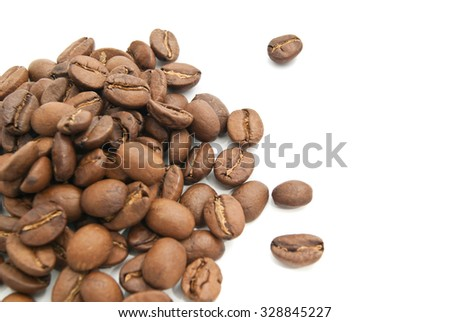 some coffee beans on white background closeup