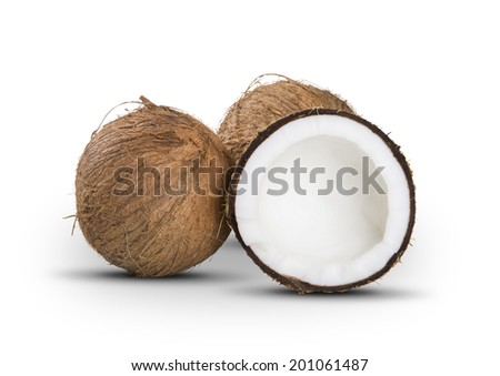 Some entire coconuts and a half on a white background