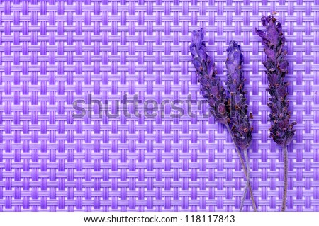 some lavender flowers on a purple woven background