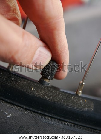 somebody controlling inflation pressure bicycle tire