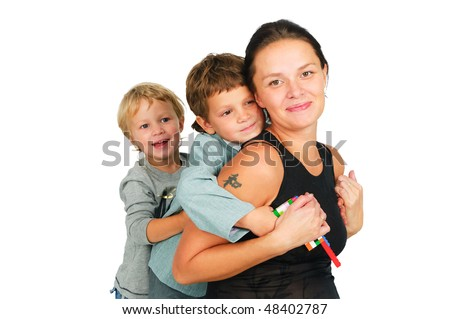 Sons love. Beautiful smiling young  pregnant mother with two sons