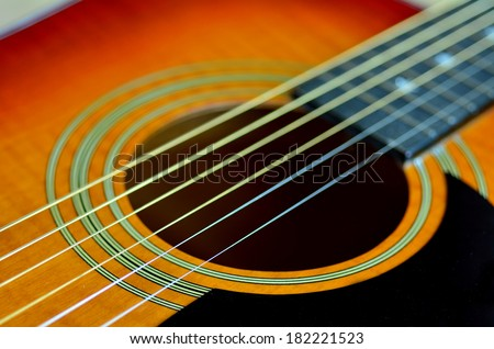 Sound-hole of six-string folk acoustic guitar. close up