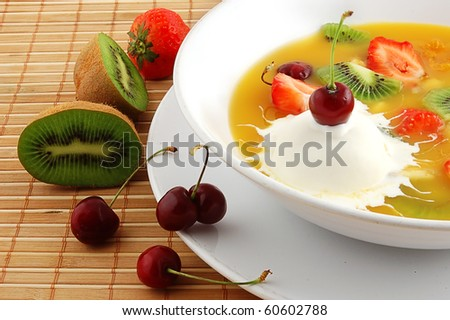 Soup from fruit and berries close up on a straw napkin