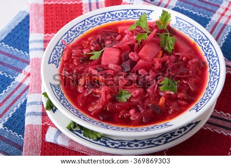 Soup of sauerkraut with beet, pearl barley and potatoes in a bowl