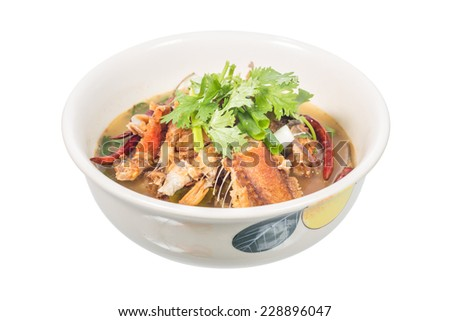 Sour and Spicy Smoked Dry Fish Soup isolated on white