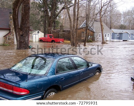 SOUTHBURY, CONNECTICUT - MARCH 7: Flooding car along the Pomperaug River on March 7, 2011 in Southbury, CT. The neighborhood is being evacuated due to the vast rainfall and the rising river.