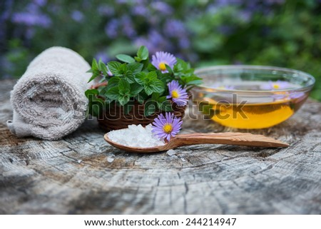 Spa and wellness setting. Manicure ans pedicure. Set with sea salt, essence, flowers fresh mint and towels. Relax and treatment therapy. Selective focus. Close up.