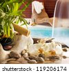Spa concept with stones orchids waterfall in pool and sunbed - stock photo