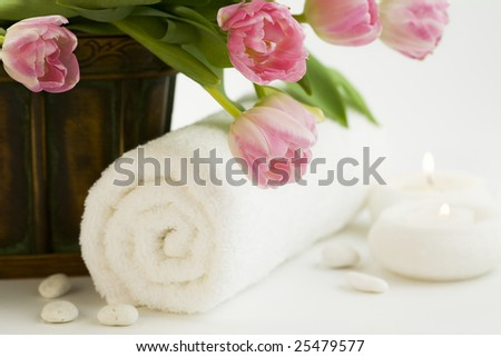 spa feeling (flowers, candle and towel). White background