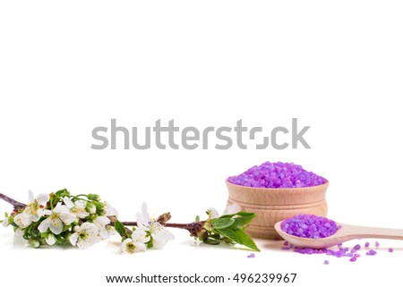 Spa sea salt and flower branch for bath. Natural health care. Beauty, healthy therapy. White background. Fresh relax for body. Treatment for relaxation and wellness. Closeup aroma crystal.