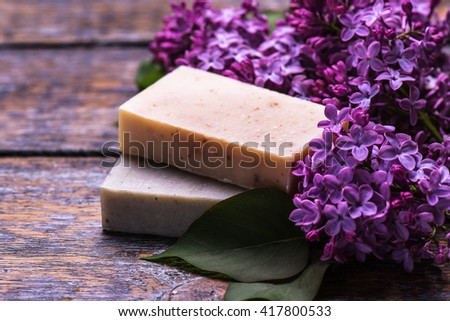 Spa setting  therapy with flowers isolated on a white wooden background.Selective focus