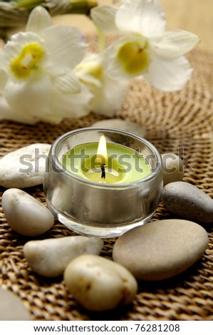 Spa setting with Gardenia, candles, and pebbles