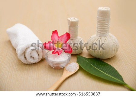 Spa setting with green leaf ,salt in bowl, rose on board