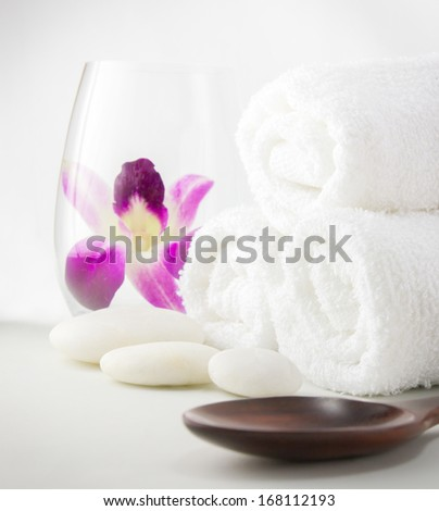 Spa setting with towels and orchid flower