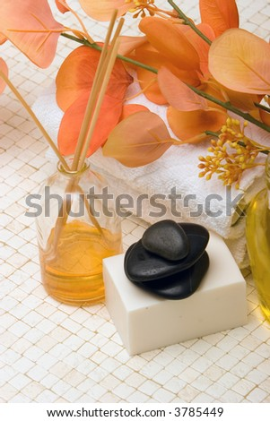 Spa towels, oils, massage stones and soap