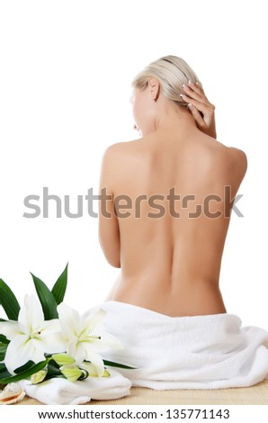 Spa Woman with flowers of a lily isolated