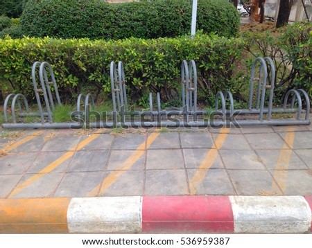 Space provided for parking bicycles or motorcycles. In various locations Contact
