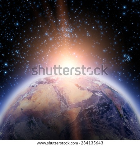 Space sunrise with stars. Good morning world! Elements of this image furnished by NASA.
