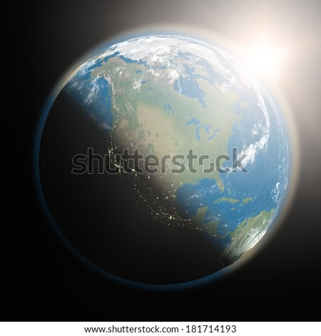 Space view of the sun rising over North America on planet Earth. Elements of this image furnished by NASA.