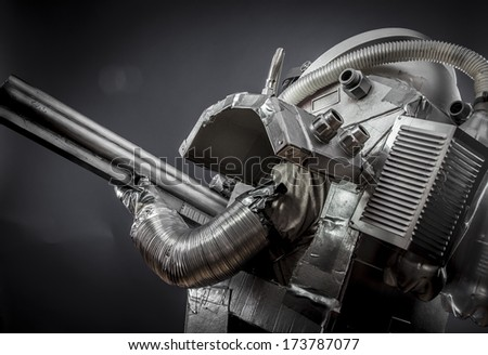 Spaceship, Astronaut on a black background with huge weapon.