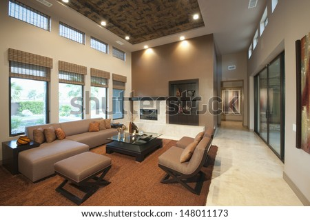 Dark wood furniture bedroom ceiling fan stock photo for Double height living room designs