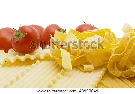 Spaghetti and mature tomato isolated on white background