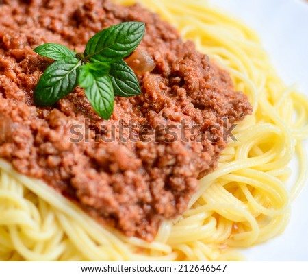 Spaghetti bolognese on white plate macro shot