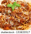 Spaghetti bolognese with grated Parmesan cheese. - stock photo