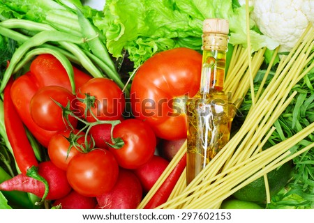 Spaghetti, vegetables and cooking oil close-up healthy eating concept