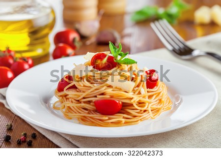 Spaghetti with tomato sauce, parmesan cheese and basil, delicious Italian food