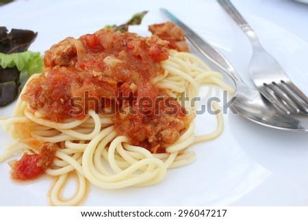 Spaghetti with tomatoes sauce in a plate.