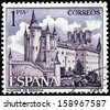 SPAIN - CIRCA 1963: A stamp printed by Spain shows view of the Alcazar of Segovia (Segovia Castle) - a stone fortification located in the old city of Segovia, Spain, circa 1963. - stock photo