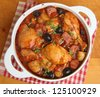 Spanish chicken casserole with chorizo, olives and new potatoes. - stock photo