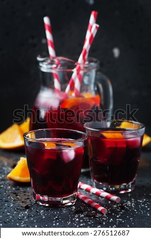 Spanish sangria with orange and lime, selective focus