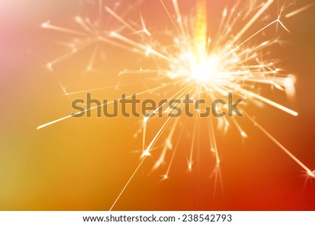 sparkler fire on red background