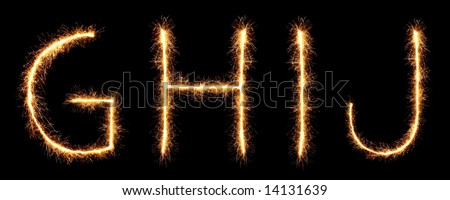 sparklers forming letters, G H I J (see more letters in my portfolio)