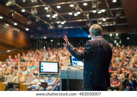 Speaker Giving Talk On Corporate Business Stock Photo